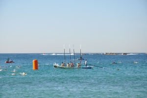 One of the Coogee surf boats lays a reef out at sea in memory of fallen lifesavers